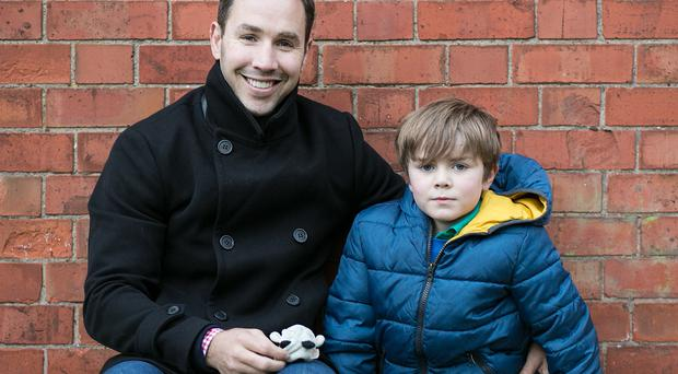 Proud dad: Former Ulster star Paddy Wallace with his son, PJ