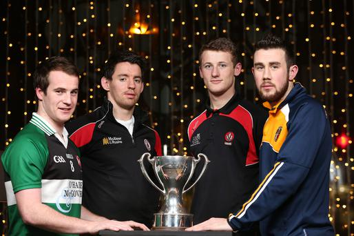 Up for the cup: Queen's Ruairí Corrigan, Mattie Donnelly of Tyrone, Antrim's Conor Murray and Brendan Rogers of Derry at the Dr McKenna Cup launchwith