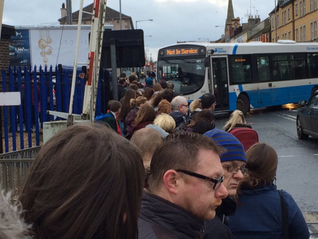 Passengers in Lurgan wait for a shuttle bus to take them to Belfast. Picture: Vincent Kearney BBC @vincekearney