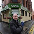 Message of defiance: The Sunflower's owner Pedro Donald has sworn to fight plans to demolish his pub. Pic: Jonathan Porter/Presseye.