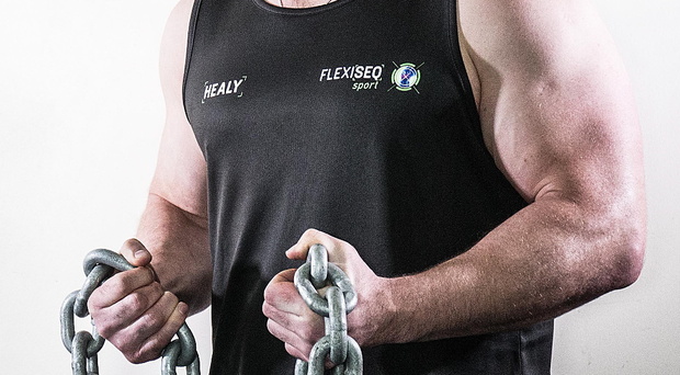 Chain reaction: Leinster and Ireland rugby star Cian Healy pictured with FLEXISEQ Sport, a drug-free gel designed to protect the joints in all active people