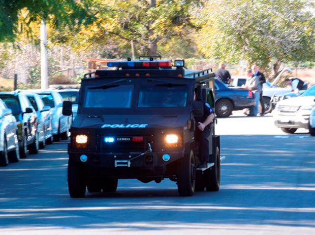 A swat team arrives at the scene of a shooting in San Bernardino, Calif., on Wednesday, Dec. 2, 2015. (Doug Saunders/Los Angeles News Group via AP) MANDATORY CREDIT