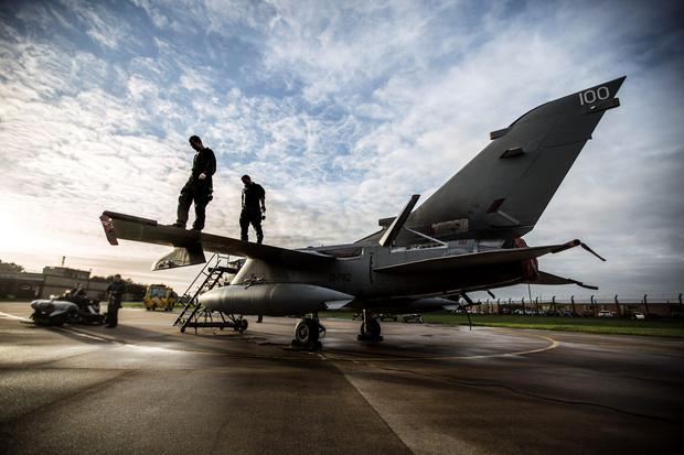 Groundcrew work on a Tornado GR4 from RAF Marham as it prepares for a practice mission, the Tornado's based at Marham in Norfolk are to reinforce the Tornado squadron at Akrotiri in Cyprus to assist in missions over Syria. PA