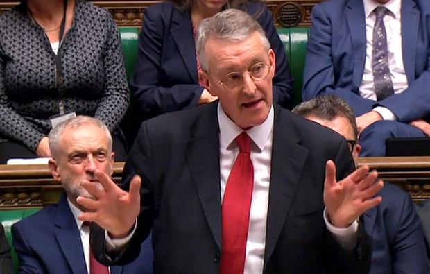 Parliament footage shows Labour Party leader Jeremy Corbyn (L) listening as foreign affairs spokesman Hilary Benn addresses the House of Commons ahead of the vote on Syria in London on December 2, 2015.
