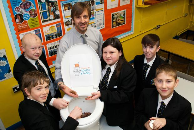 Mr Bennett with Carrickfergus College pupils.