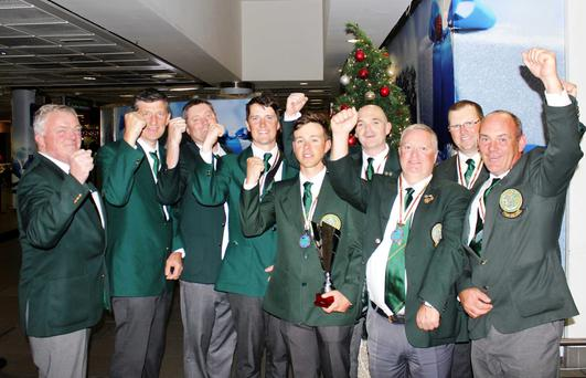 Top rods: Ireland's shore angling team (from left) IFSA Chairman Micheál Quinn, Harry McKee snr, Mick Mullane, Harry McKee jnr, captain Dean Quigley, Richie Dalton, John O'Brian, Martin Howlin and Joe Byrne celebrate bronze medal success on arrival at Dublin Airport after the World Championships in Portugal