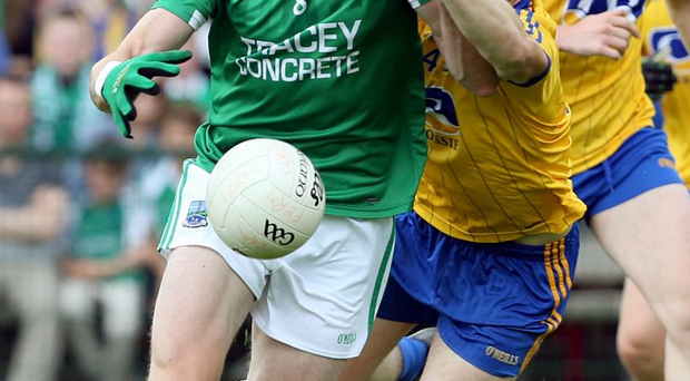 On the ball: Eoin Donnelly is the perfect role model, having come from the small Coa O'Dwyers club to captain Fermanagh and Ulster