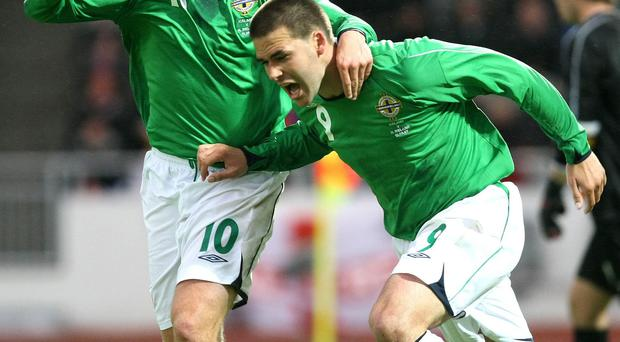 Northern Ireland's David Healy and Warren Feeney celebrates scoring against Iceland