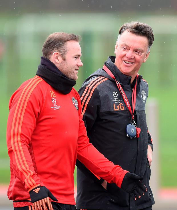 Bitter blow: Louis van Gaal is likely to be without Wayne Rooney for at least two games, including the crucial Champions League clash in Wolfsburg, after the striker picked up an ankle injury