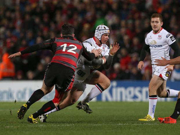 Ulster's Luke Marshall in action with Edinburgh's Matt Scott. Pic: Matt Mackey/Presseye.