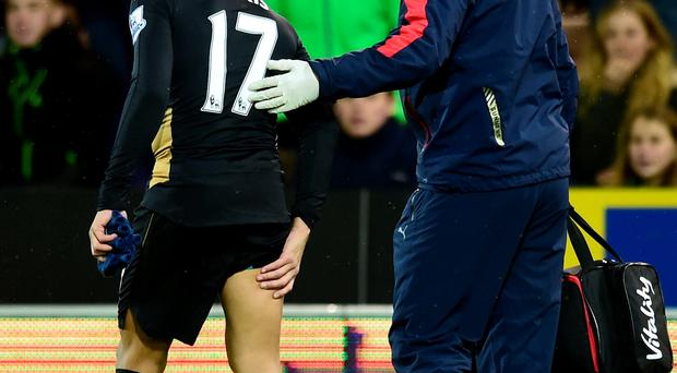 Injury blow: Alexis Sanchez had already hurt his hamstring before being pushed into a camera pit at Carrow Road