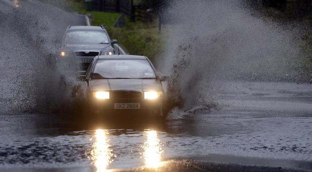 Motorists struggle through Storm Desmond floods in Glenavy, Co Antrim Pic Colm Lenaghan/ Pacemaker