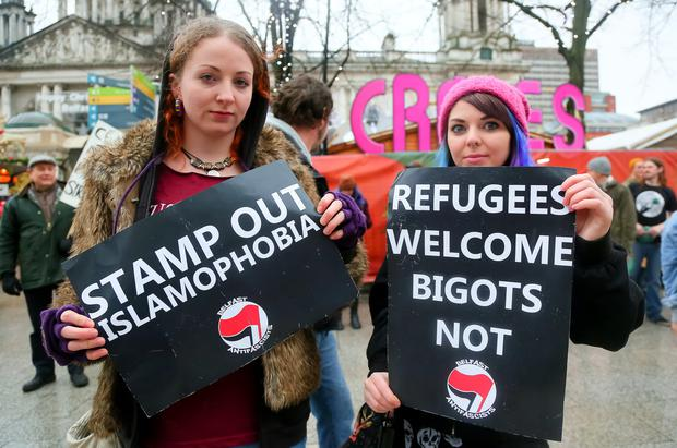 Pictured are counter protesters Niamh Muldoon and Christine Ramsey at the anti-refugee rally organised by the Protestant Collation held in Belfast, Northern Ireland on December 05 (Photo by Kevin Scott / Presseye )