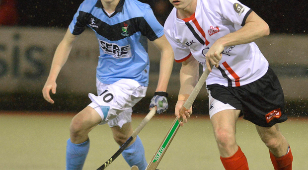 On the move: Annadale's Robbie McGuire builds up another attack with Lisnagarvey scorer Sean Murray in close attendance