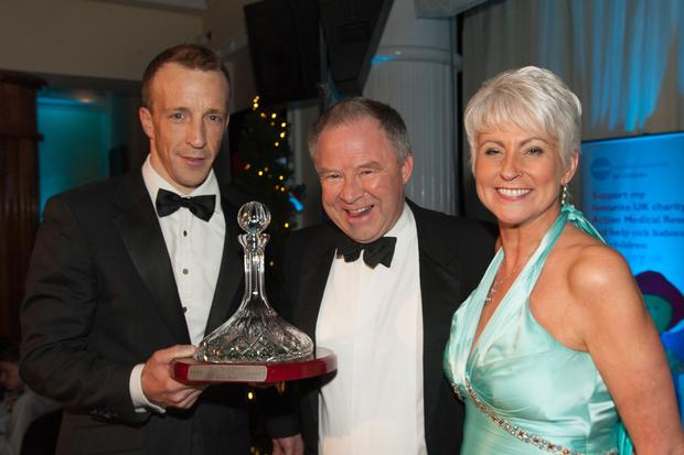 Bobby dazzlers: Circuit of Ireland rescuer Bobby Geddis (centre) collects his Contribition to Motorsport award from World Rally Championship driver Kris Meeke and Pamela Ballantine of the SPARKS NI charity committee