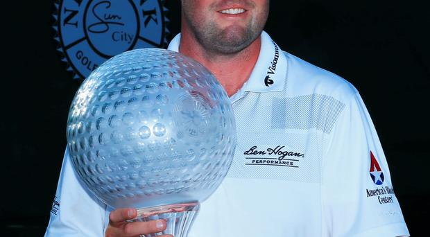 Prize guy: Australian Marc Leishman lifts the Nedbank Golf Challenge title, his first European Tour triumph, to bring a testing year to a close