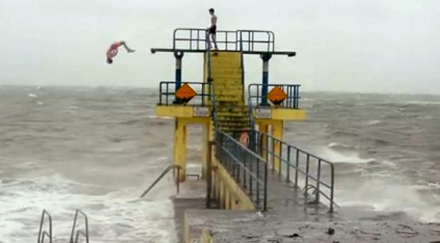 Two youths dive into the sea at Salthill, in a video that has been viewed over a million times
