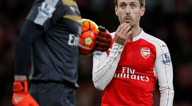 Here's looking at you: Petr Cech and Nacho Monreal during Arsenal's 3-1 win over Sunderland at the weekend