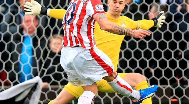 On target: Stoke's Marco Arnautovic scores past Man City's Joe Hart during their game on Saturday