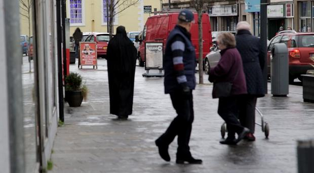 Pictured Sunday Life report Angela Rainey wearing a burqa/burka in social experiment to personally gauge the Northern Irish public's reaction to the dress custom. Carrickfergus Picture Mark McCormick 04/12/15