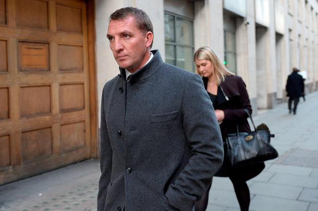 Former Liverpool manager Brendan Rodgers leaves the Central Family Court in London. PA