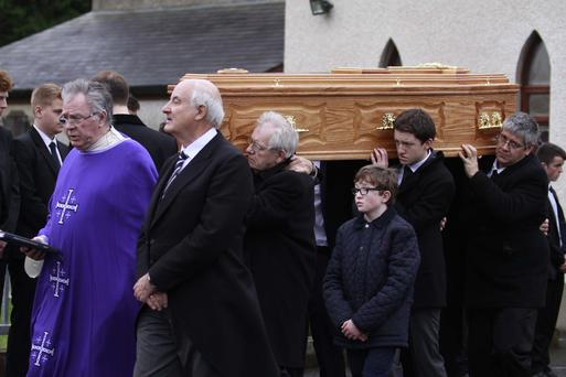 A Priest at St Mary's Church Rasharkin leads family members of the late Conor McKeown who died suddenly as he came across a RTA on the outskirts of Portglenone on Friday. Mr McKeown was a Managing Director of a Turkey Farm.PICTURE MARK JAMIESON.