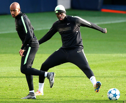 On the way back: Yaya Toure (right) in training ahead of his return to the Manchester City team to face Borussia Monchengladbach