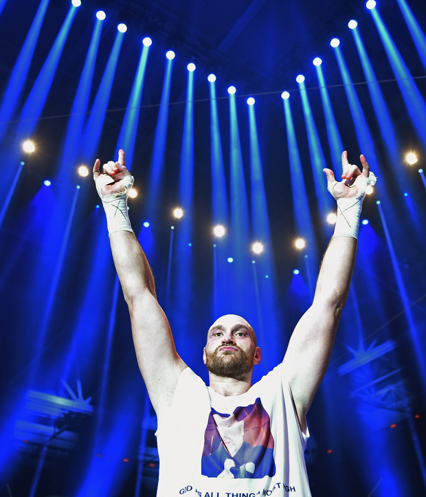 Champion: Tyson Fury laps up the applause in Germany