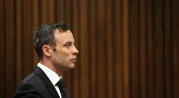 Oscar Pistorius sits in the dock in a courtroom at the High Court in Pretoria, South Africa, Tuesday Dec. 8, 2015. (AP Photo/Siphiwe Sibeko, Pool)