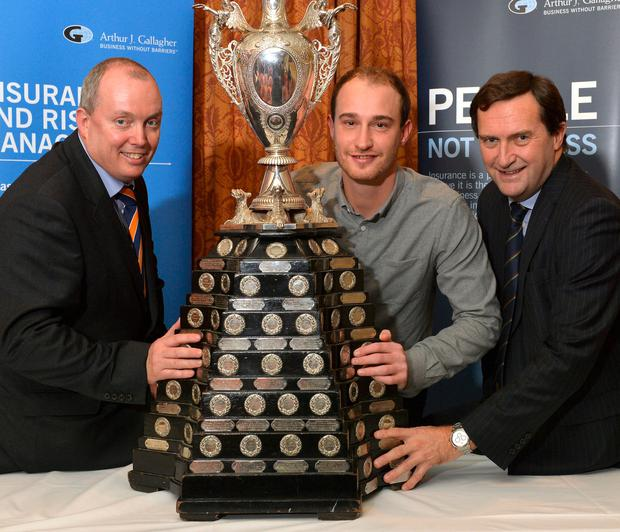 Chris Dougherty, captain of holders CIYMS, flanked by Gordon Markey (left), broking director of new sponsors Arthur J Gallagher and Peter McMorran, president of the NCU at last night's Cup draw