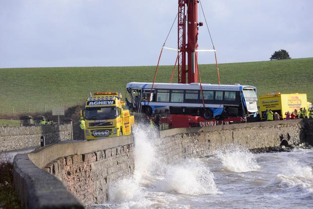 The bus is lifted back onto the land. Pacemaker.