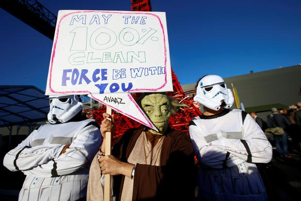 Global citizens movement Avaaz in a Star Wars themed stunt with Yoda and two storm-troopers pose during a protest for Paris climate agreement to put the world on course for clean energy front of the mini red Eiffel Tower replica during the COP21, United Nations Climate Change Conference in Le Bourget, north of Paris, France, Wednesday, Dec. 9, 2015. (AP Photo/Francois Mori)
