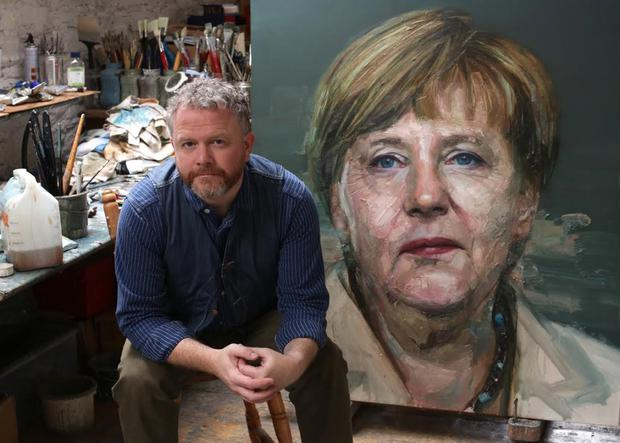 Belfast artist Colin Davidson with his portrait of Angela Merkel
