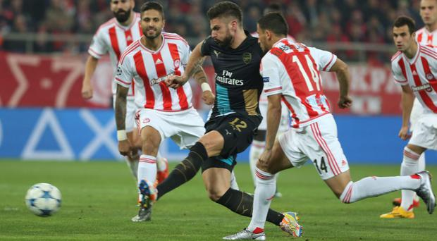 Arsenal's Olivier Giroud scores during a Champions League Group F soccer match between Olympiakos and Arsenal at the Georgios Karaiskakis stadium in Piraeus port, near Athens, Wednesday, Dec. 9, 2015. (AP Photo/Petros Giannakouris)