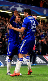 Chelsea's Willian celebrates scoring his side's second goal of the game with Diego Costa during the UEFA Champions League match at Stamford Bridge, London. PRESS ASSOCIATION Photo. Picture date: Wednesday December 9, 2015. See PA story SOCCER Chelsea. Photo credit should read: Nick Potts/PA Wire