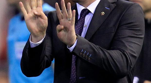 Valencia's head coach Gary Neville signals during a group H Champions League soccer match between Valencia and Lyon at the Mestalla stadium in Valencia, Spain, Wednesday Dec. 9, 2015. (AP Photo/Alberto Saiz)