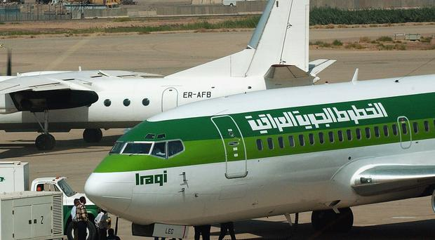 An Iraqi Airways Boeing 737 sits on the tarmac at Baghdad International Airport September 18, 2004 Baghdad, Iraq, when the national carrier launched its first international flight in 14 years since U.N. sanctions were imposed on Saddam Hussein.
