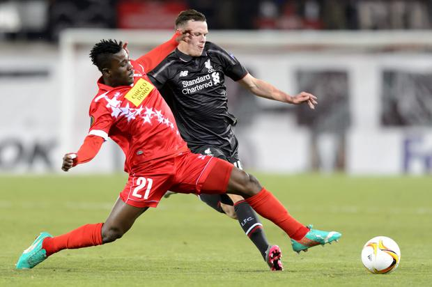 Sion's Ebenezer Assifuah, left, vies for the ball with Liverpool's Bradley Smith, right, during the Europa League group B soccer match between FC Sion and FC Liverpool at the Tourbillon stadium in Sion, Switzerland, Thursday, Dec 10, 2015. (Laurent Gillieron/Keystone via AP)