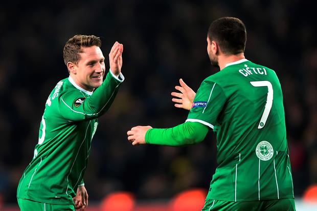 Celtic's Kris Commons (L) celebrates with his teammate Tom Rogic (R) after scoring during the UEFA Europa League football match between Fenerbahce and Celtic at Fenerbahce Sukru Saracoglu stadium in Istanbul on December 10, 2015. AFP/Getty Images