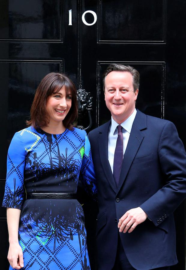 Christmas card photo shows Prime Minister David Cameron and his wife Samantha returning to Downing Street after seeing the Queen to form a new government. Photo: Stephen Lock / i-Images