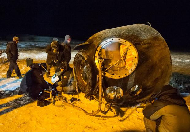 A search and rescue team works on the site of landing of the Soyuz TMA-17M capsule with the International Space Station crew near the town of Dzhezkazgan, Kazakhstan, Friday, Dec. 11, 2015. (Andrey Shelepin/Pool Photo via AP)