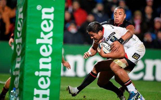 Nearly there: Nick Williams is about to break through a tackle before scoring Ulster's first try in their 38-0 rout of Toulouse