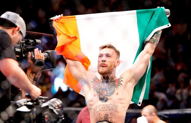 Conor McGregor celebrates after a first-round knockout victory over Jose Aldo in their featherweight title fight during UFC 194 at MGM Grand Garden Arena on December 12, 2015 in Las Vegas, Nevada. (Photo by Steve Marcus/Getty Images)