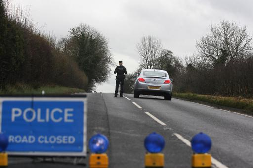 Police near the scene of the accident on the Magheraknock Road. Pic: Matt Bohill/ Pacemaker.