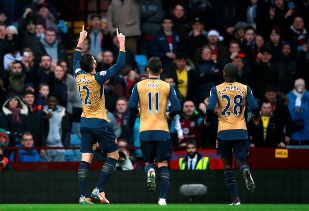 Arsenal's Olivier Giroud (left) celebrates scoring his side's first goal of the game from the penalty spot during the Barclays Premier League match at Villa Park, Birmingham. David Davies/PA Wire.