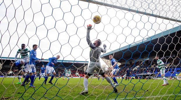 Hot shot: Celtic's Dedryck Boyata (extreme left) scores his second goal of the day at McDiarmid Park