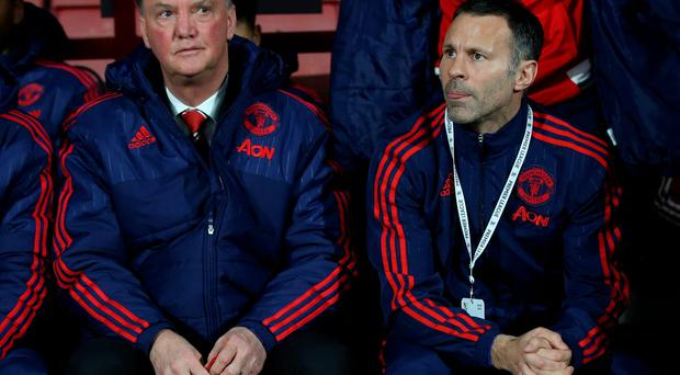 Grim: Louis van Gaal and Ryan Giggs watch horror show unfold at Bournemouth