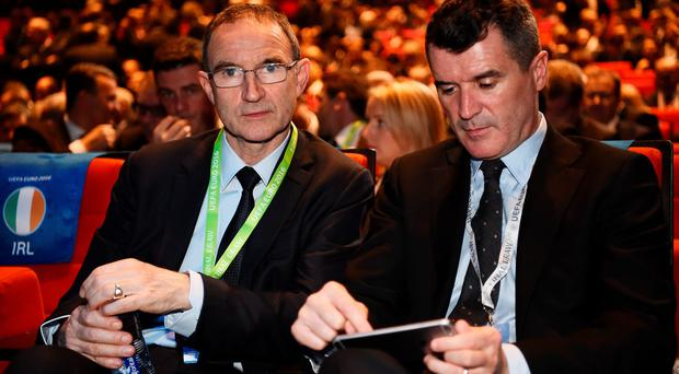 Draw date: Republic of Ireland manager Martin O'Neill with his assistant Roy Keane