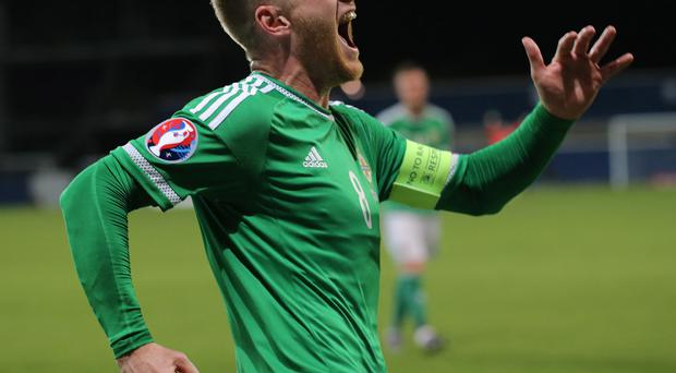 Pacemaker Belfast 08-10-15 Northern Ireland v Greece - Euro 2016 Qualifier Northern Ireland's Steven Davis celebrates his goal during this evening's game at Windsor Park in Belfast. Photo David Maginnis/Pacemaker Press