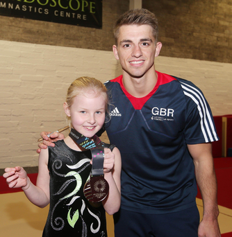 Olivia Davidson, from Lisburn, gets an autograph from Max Whitlock